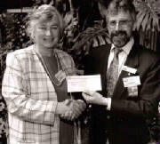 MInister of Municipal Affairs, Darlene Mazarie, and former Mayor Guenter Rieger 1995